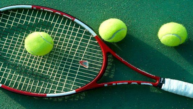 a tennis racket and 3 balls