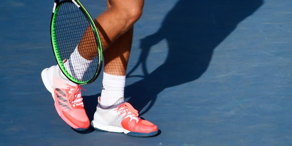 Tennis shoes on court