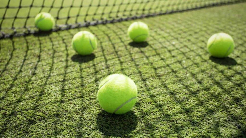 tennis balls on a grass court